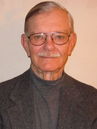 Former Willistion Education Ron Thue, an old gentleman with a grey mustache and glasses.